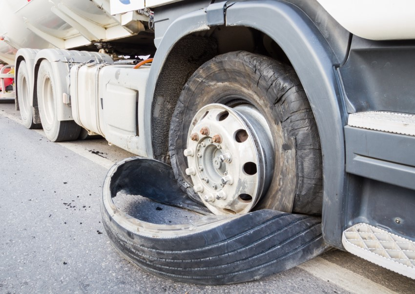flat tire on a semi truck needing a towing service